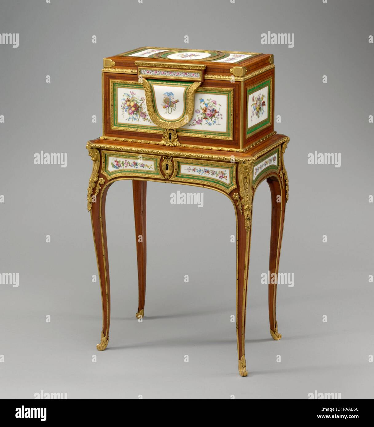 Jewel coffer on stand (petit coffre à bijoux). Culture: French, Paris and Sèvres. Decorator: Eight plaques decorated by Jean-Jacques Pierre the Younger (French, active 1763-1800); One plaque decorated by Michel-Gabriel Commelin (French, 1746-1802). Dimensions: 37 1/2 x 21 3/4 x 14 1/2 in. (95.3 x 55.2 x 36.8cm). Factory: Porcelain plaques by Sèvres Manufactory (French, 1740-present). Maker: Coffer attributed to Martin Carlin (French, near Freiburg im Breisgau ca. 1730-1785 Paris). Date: ca. 1770.  In 1770, the year the Austrian archduchess Marie-Antoinette (1755 - 1793) married Louis-Auguste,  Stock Photo