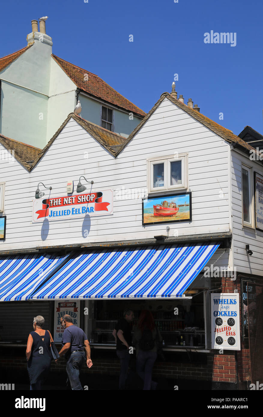The Jellied Eels Bar,in the Net Shop, selling whelks, cockles and eels, on Hastings harbour, in East Sussex, UK - Stock Image