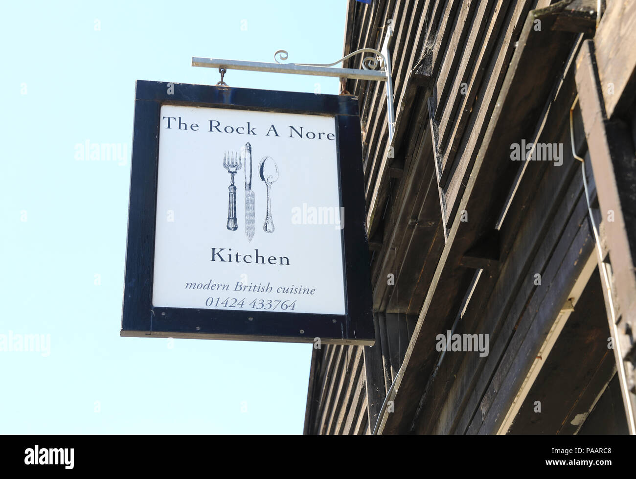 The Rock-a-Nore Kitchen restaurant in one of the black wooden sheds, known as the 'Net Shops', in Hasting's old fishing quarter,in East Sussex, UK - Stock Image