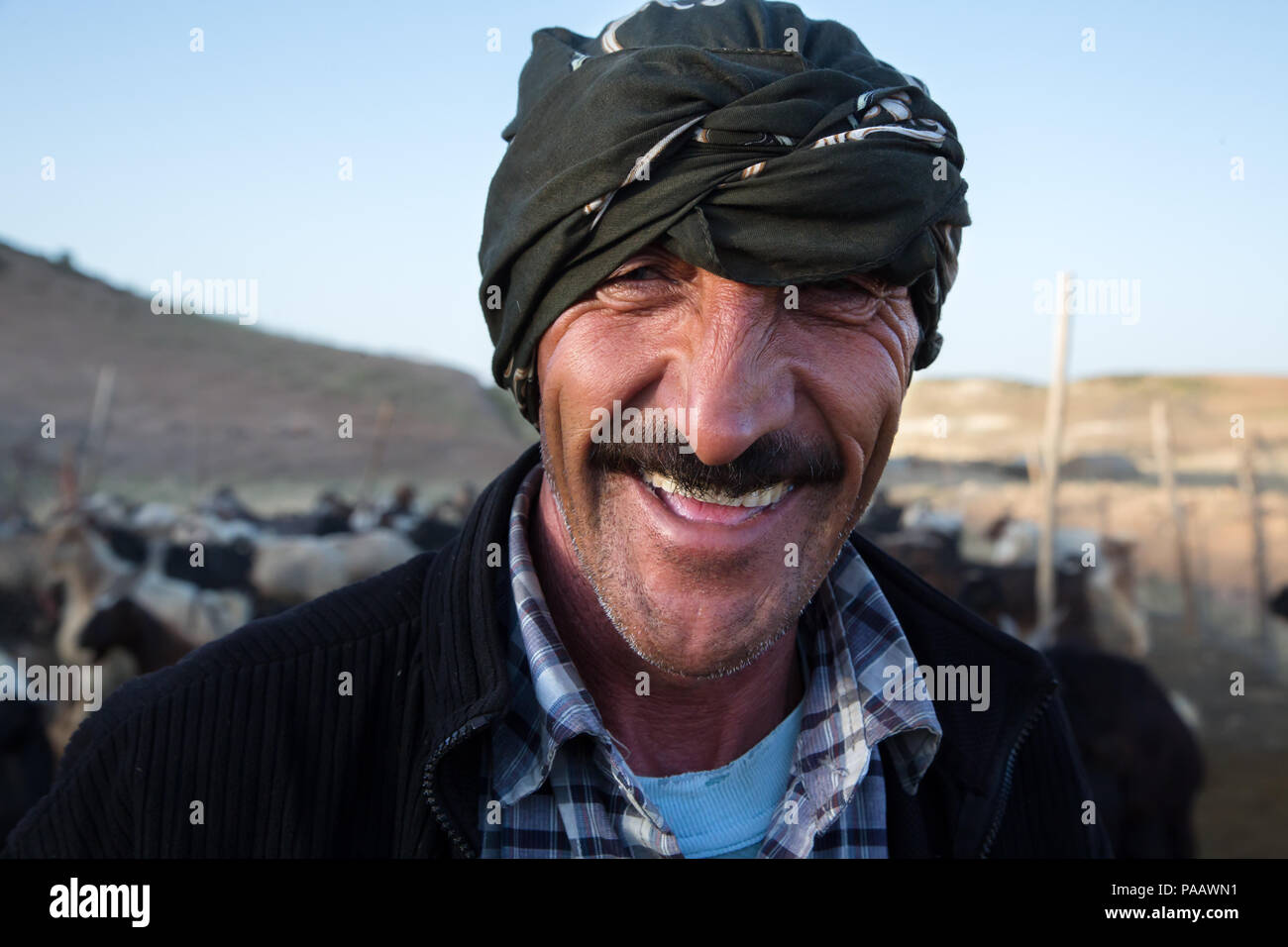 Portrait of smiling Qashqai man , nomad people, Iran - Stock Image