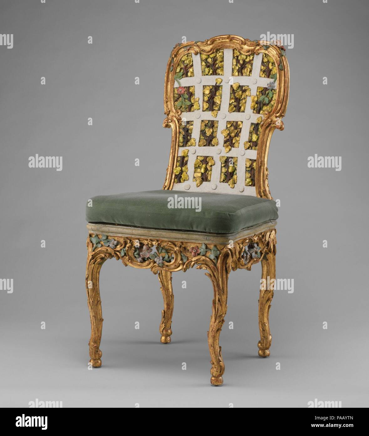 Side chair (one of four) (part of a set). Culture: German, Würzburg. Dimensions: 39 1/2 x 19 1/4 x 17 1/2 in. (100.3 x 48.9 x 44.5cm). Maker: Attributed to Johann Michael Bauer (German, Westheim 1710-1779 Bamberg). Date: ca. 1763-64.  The settees and chairs illustrated here (see 1974.356.114-.121) were made for the Franckenstein Pavilion in the gardens of Seehof Castle near Bamberg, one of the three summer residences in Southern Germany used by Adam Friedrich von Seinsheim, prince bishop of Würzberg and Bamberg. A true garden enthusiast, it was under von Seinsheim that the gardens of Seehof we - Stock Image