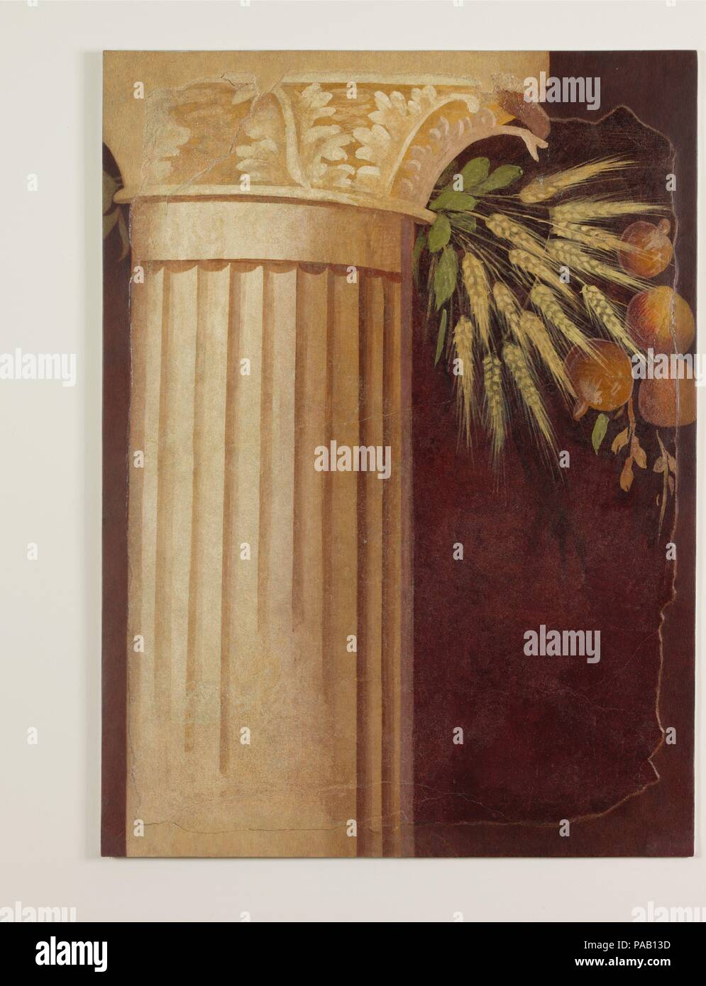 Wall painting fragment from the peristyle of the Villa of P. Fannius Synistor at Boscoreale. Culture: Roman. Dimensions: Overall: 35 3/4 x 25 1/2in. (90.8 x 64.8cm). Date: ca. 50-40 B.C..  Corinthian column with festoon of grain and fruit; from peristyle of the Villa of P. Fannius Synistor at Boscoreale. Museum: Metropolitan Museum of Art, New York, USA. - Stock Image