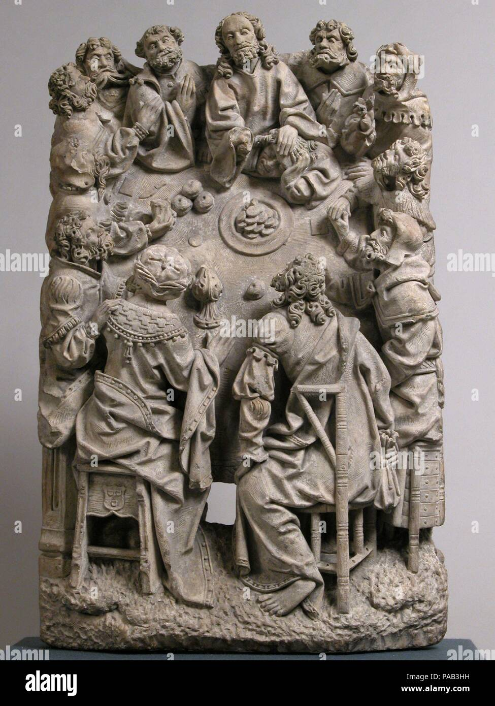 The Last Supper. Culture: German or South Netherlandish. Dimensions: Overall: 25 x 15 1/2 x 6 1/2 in. (63.5 x 39.4 x 16.5 cm). Date: ca. 1500-1530.  This scene of the Last Supper clearly shows each disciple, including Judas, who is seen at the lower right clutching his bag of money, a reference to his future betrayal. The elaborate and detailed carving indicates that the sculpture came from an important ecclesiastical setting, such as a sacrament house that contained the elements for celebrating mass. Cologne Cathedral contained such a structure, made by the sculptor Franz Maidburg (d. 1533),  - Stock Image