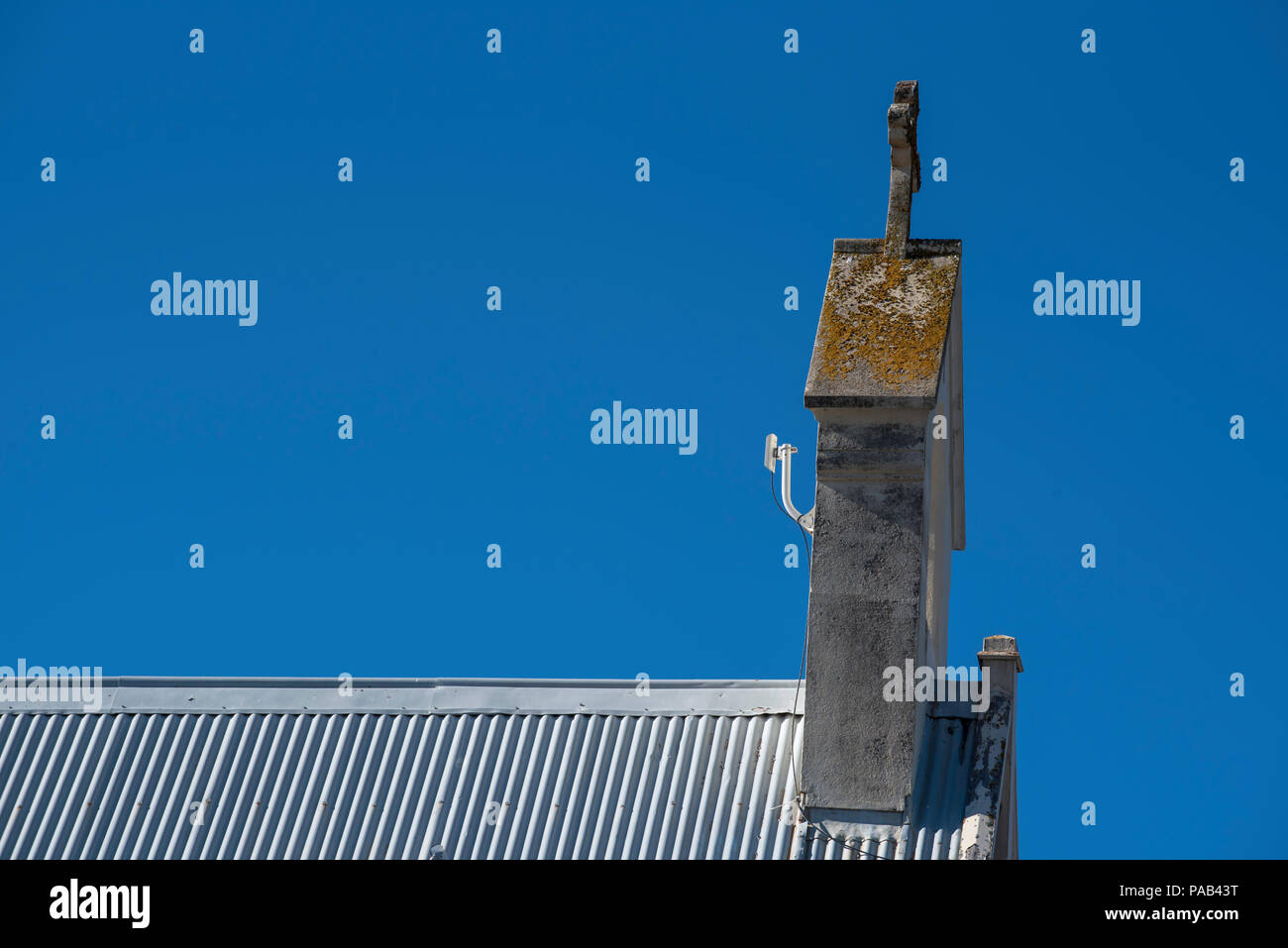 A wireless Internet receiver attached to the rear of a bell gable, espadaña espadanya, clocher-mur or campanile a vela on a church roof in Australia - Stock Image