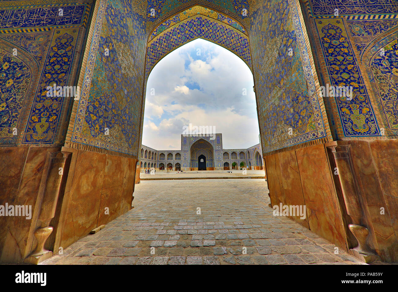 Shah Mosque known also as Imam Mosque through monumental gate, located in Naghshejehan square, in Isfahan, Iran - Stock Image