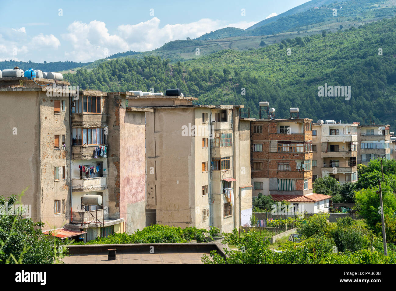 Typical old communist era apartment blocks of poor quality in the town of Memaliaj in Southern Albania. - Stock Image