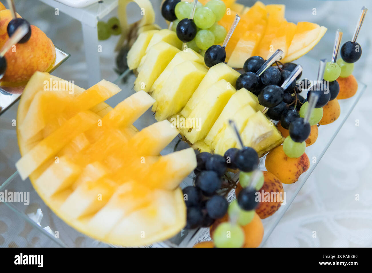 Feautiful fruit buffet served for guests at wedding. - Stock Image