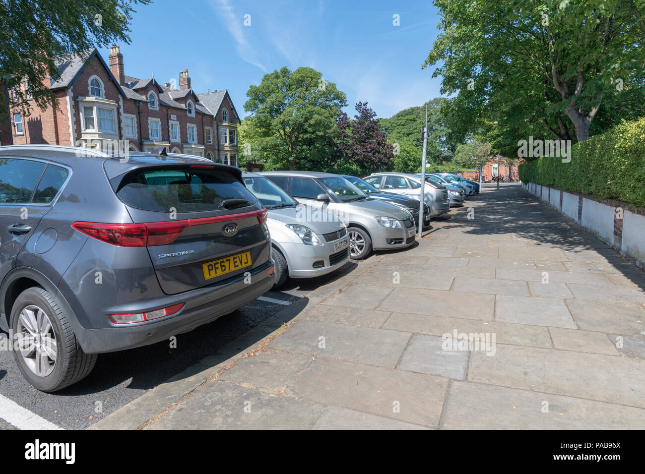 Row of cars parked at right angles to the pavement in a side street in Lytham, Lancashire - Stock Image