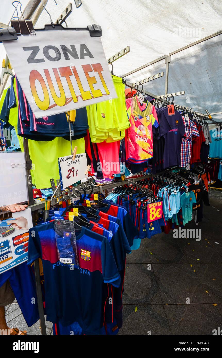Tarragona, Spain - July 12, 2018: Street market outlet on Rambla Nova in Tarragona selling football merchandise including Barcelona football club jers - Stock Image