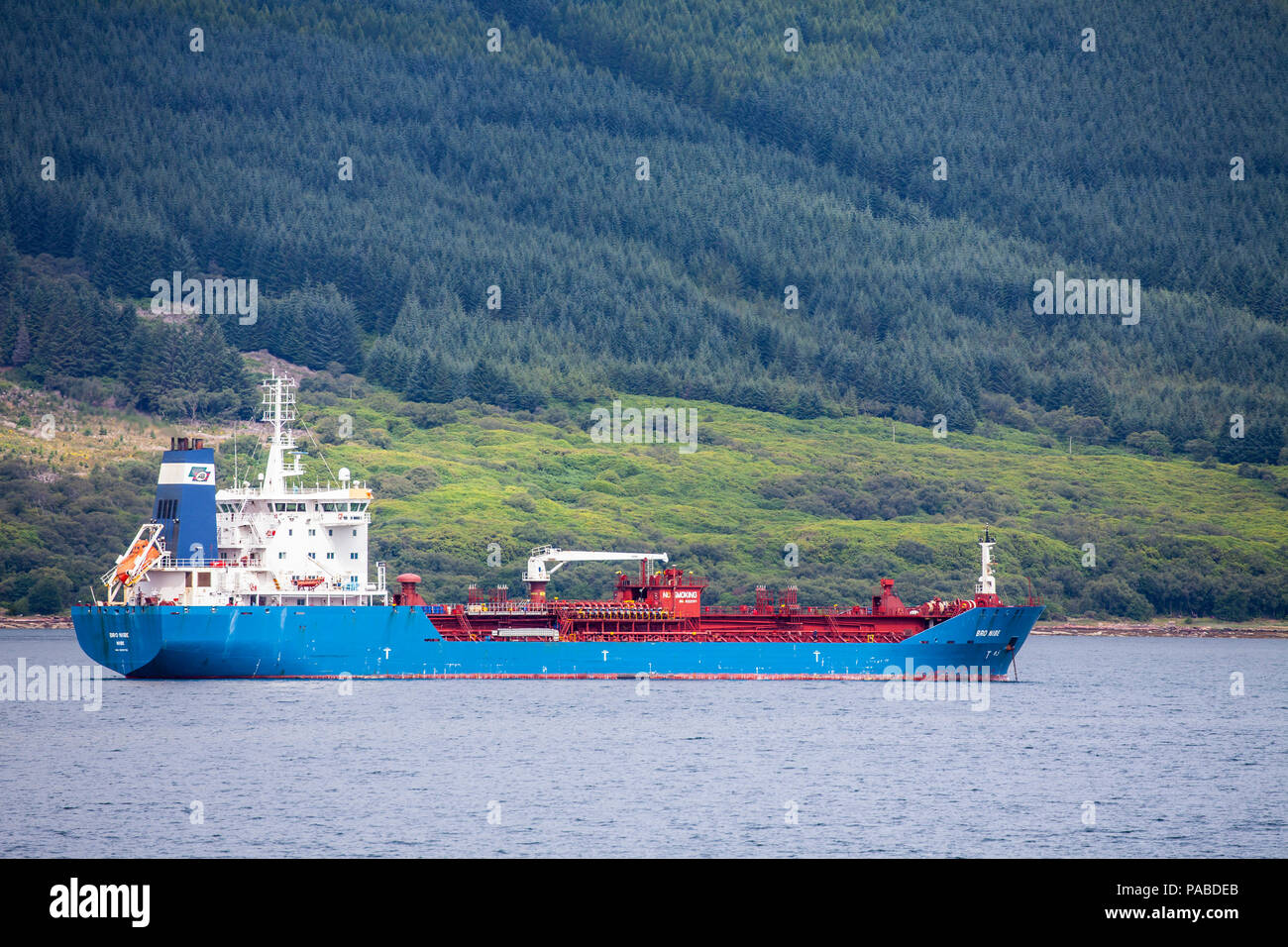 Danish oil and chemical tanker Bro Nibe (2007) operated by Broström AB, part of the Maersk Group, anchored off the Isle of Arran, Firth of Clyde - Stock Image