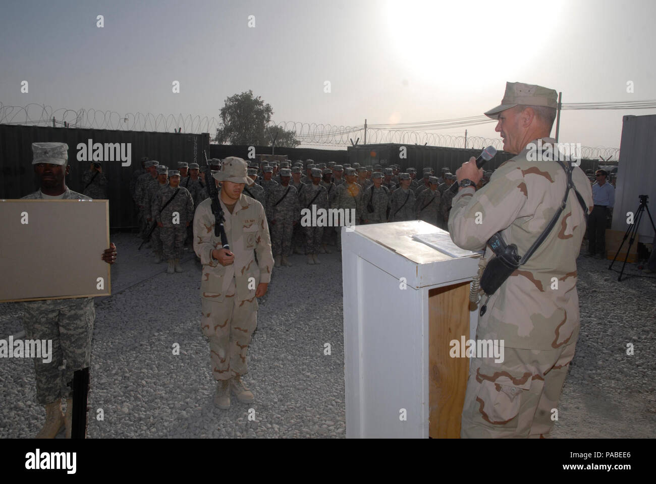 Capt. Kelly Schmader, commander of the 30th Naval Construction Regiment, delivers a message to service members during a memorial ceremony held at Kandahar Airfield. Sailors assigned to 30NCR and soldiers assigned to the 143D Expeditionary Sustainment Command, take time to honor those who lost their lives on Sept 11, 2001, and to pay tribute to the servicemen and women that have paid the ultimate sacrifice in support of Operations Iraqi Freedom and Enduring Freedom. 30NCR, homeported in Port Hueneme, Calif., and the 143d ESC, based in Orlando, Fla., are deployed to Afghanistan in support of Ope - Stock Image