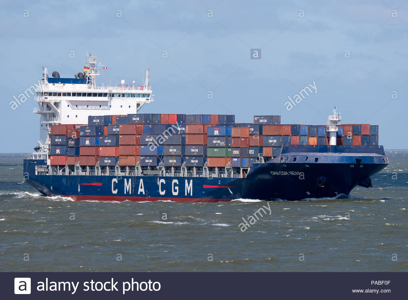 The container ship CMA CGM NEVA on the way to the port of Hamburg - Stock Image