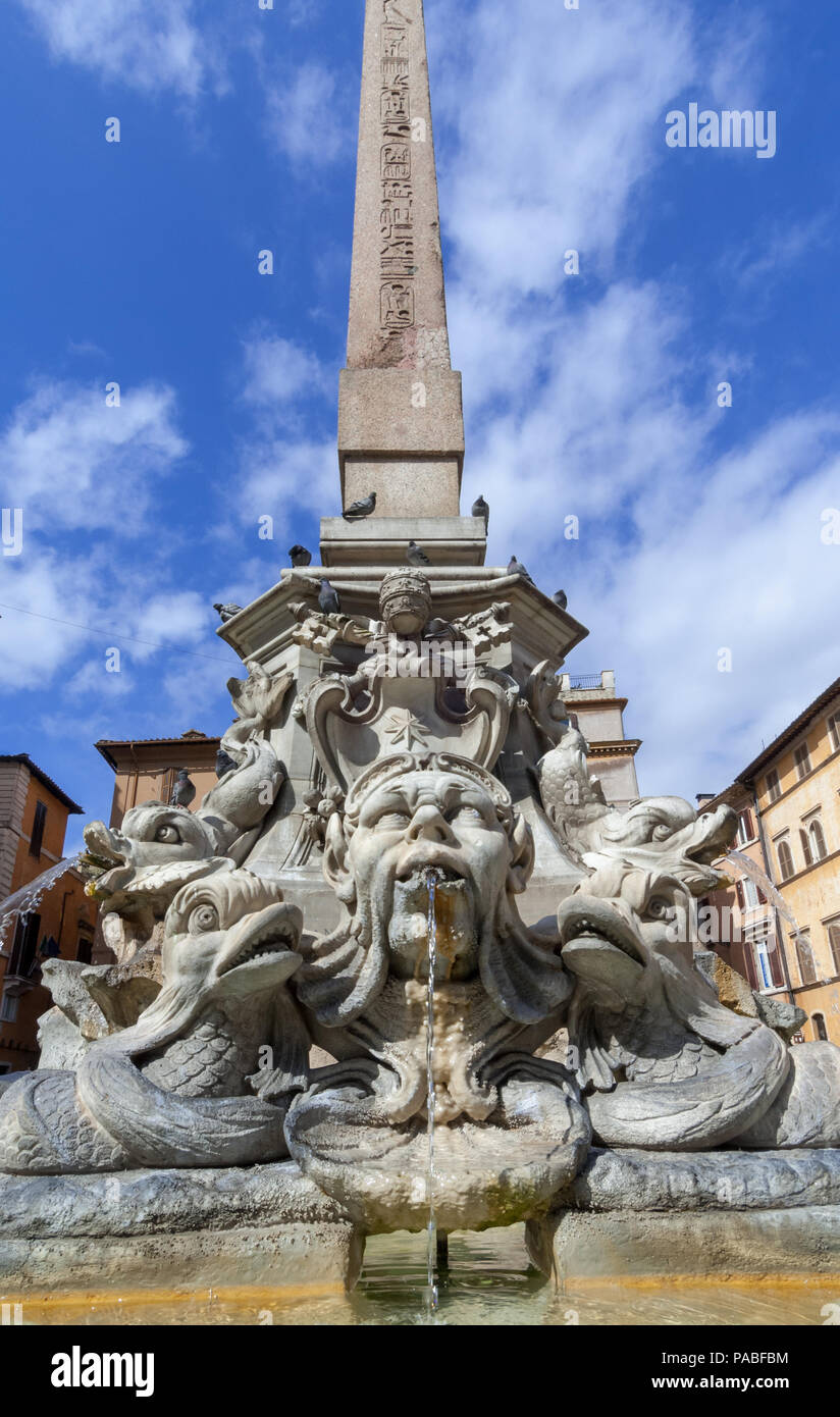 Fontana della Rotonda, or Pantheon Fountain, in Piazza della Rotonda in Rome with mythical creatures in the basin and Ramses II's Egyptian obelisk. - Stock Image