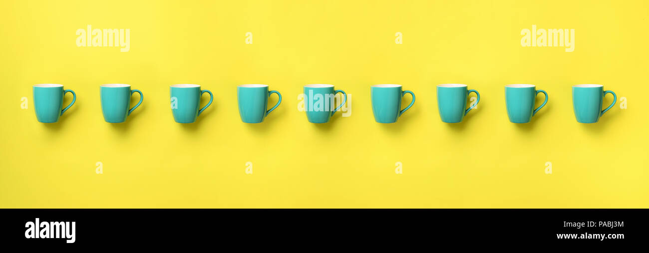 Pattern from blue cups over yellow background  Banner