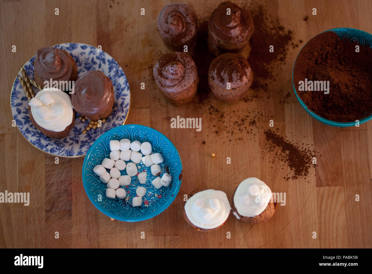Set for cooking . celebration cupcakes, chocolate muffins on the table - Stock Image