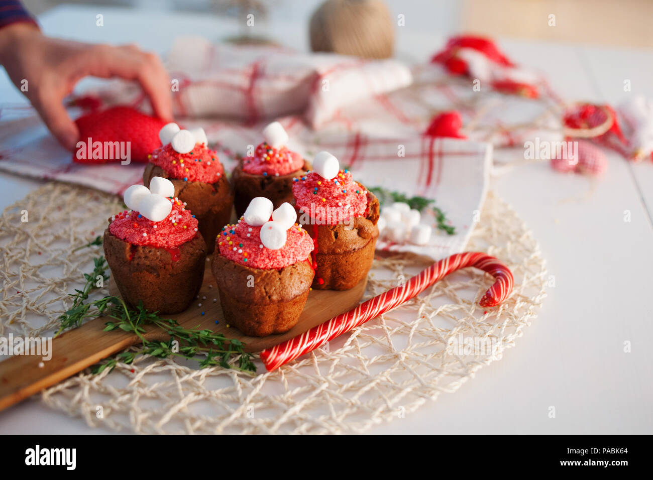 New Year celebration cupcakes, chocolate muffins on the table - Stock Image
