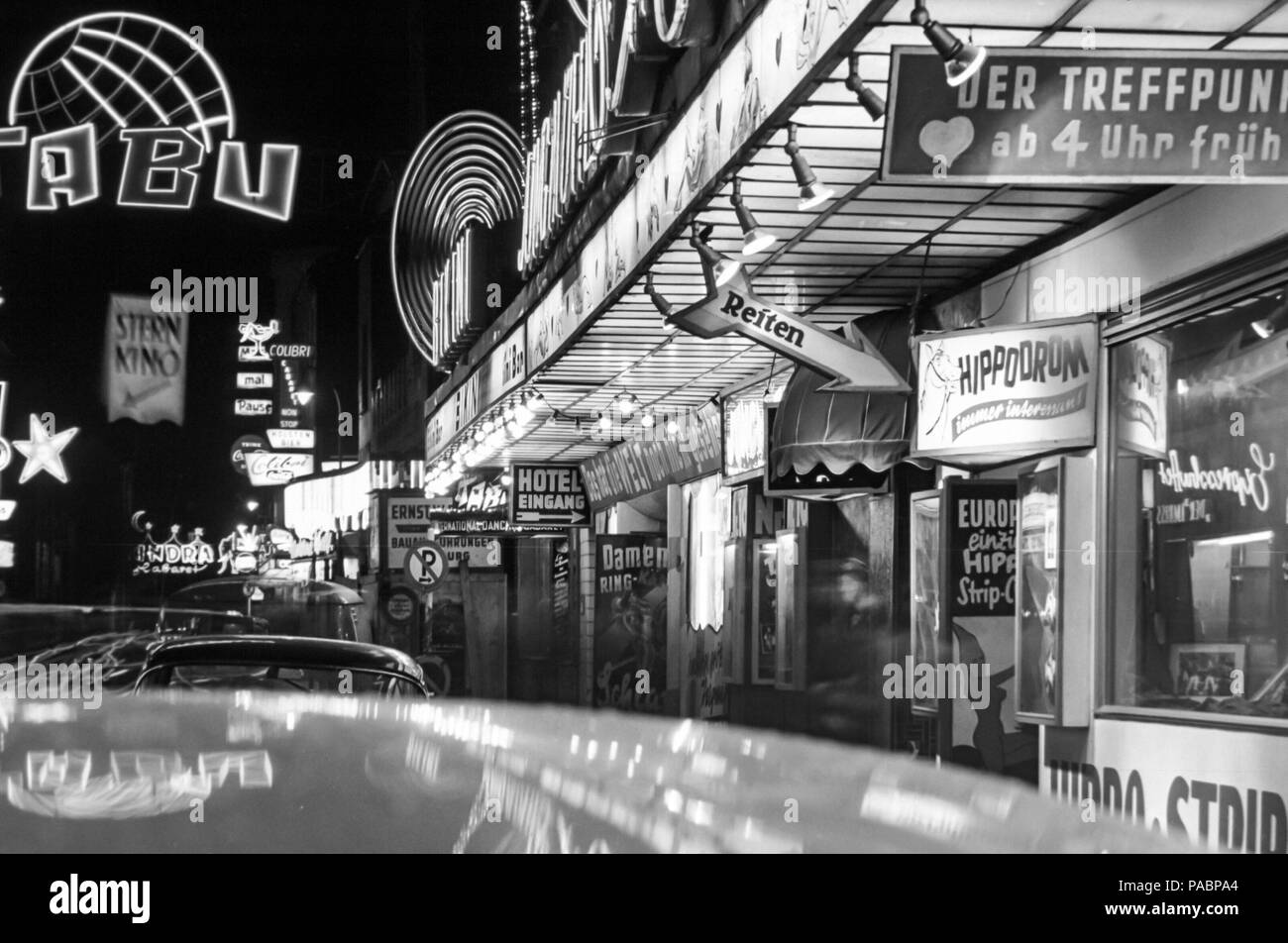 1960s black and white night photo of the neon lights of the night clubs in grosse. Black Bedroom Furniture Sets. Home Design Ideas