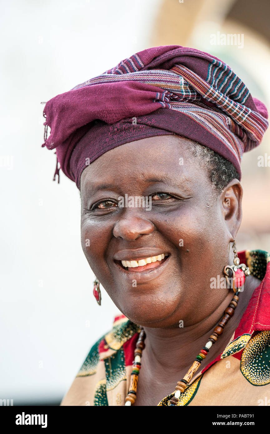 ACCRA, GHANA - MARCH 2, 2012: Unidentified Ghanaian woman smiles. People of Ghana suffer of poverty due to the unstable economic situation - Stock Image