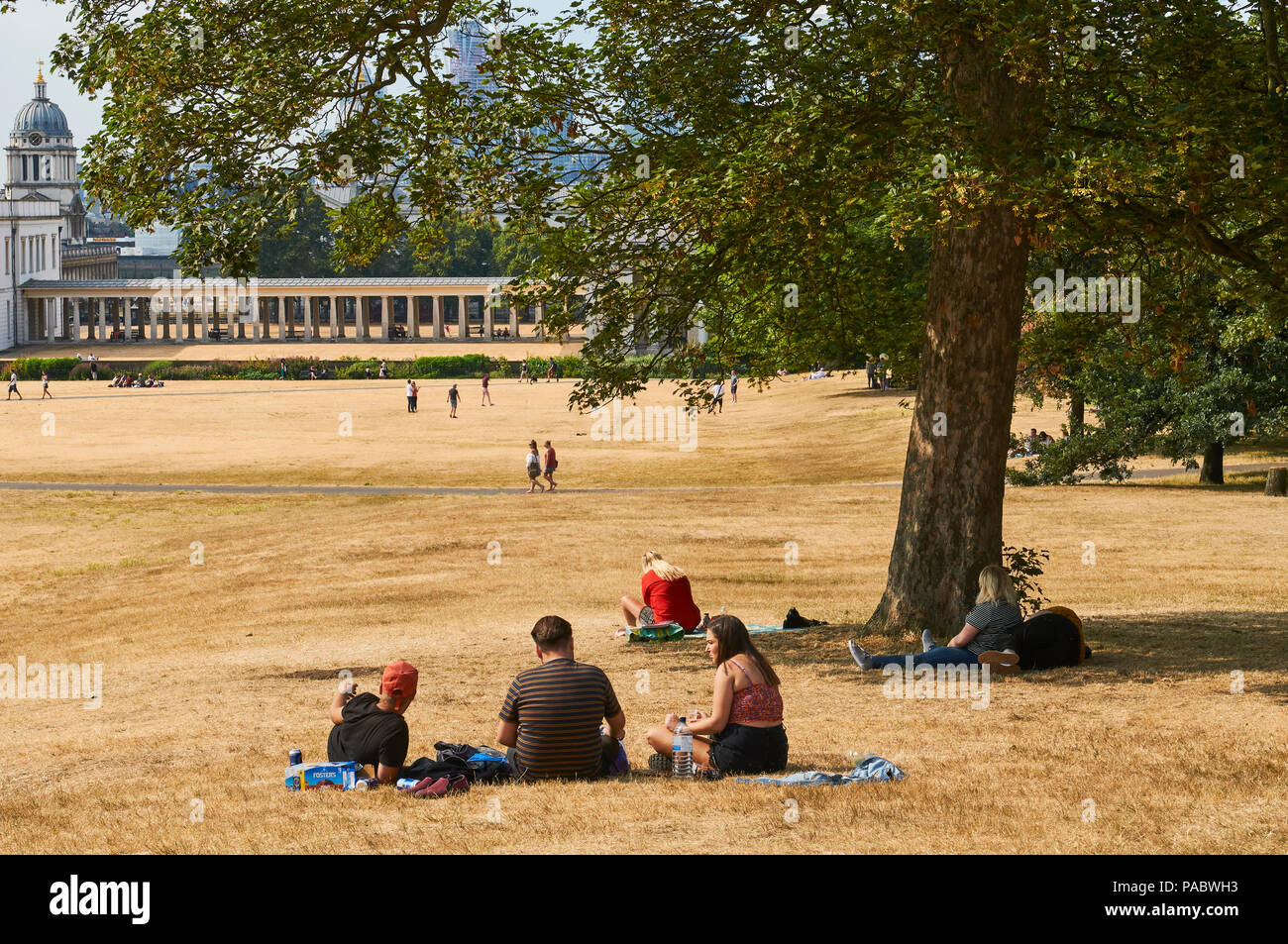 People enjoying the hot weather in Greenwich Park, South East London, during the 2018 heatwave - Stock Image
