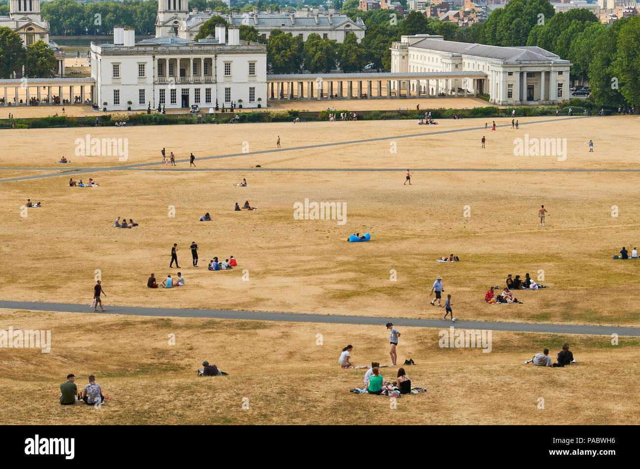 Greenwich Park, South East London, UK, in the summer heatwave of 2018, with parched grass and crowds - Stock Image