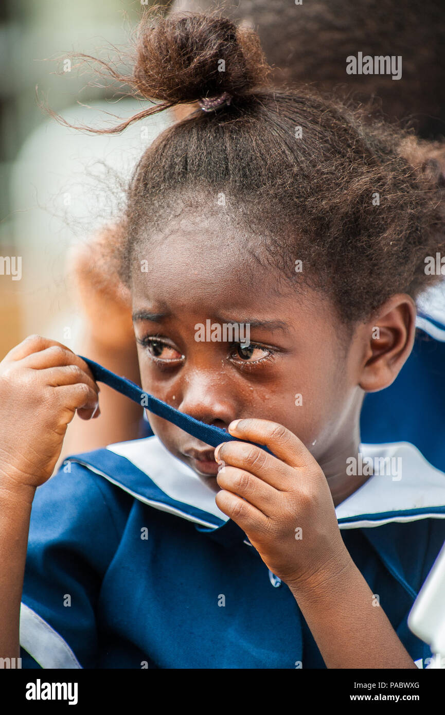 ACCRA, GHANA - MARCH 4, 2012: Unidentified Ghanaian girl cries in a school uniform in Ghana. School uniform is a part of the humanitarian help to Afri - Stock Image