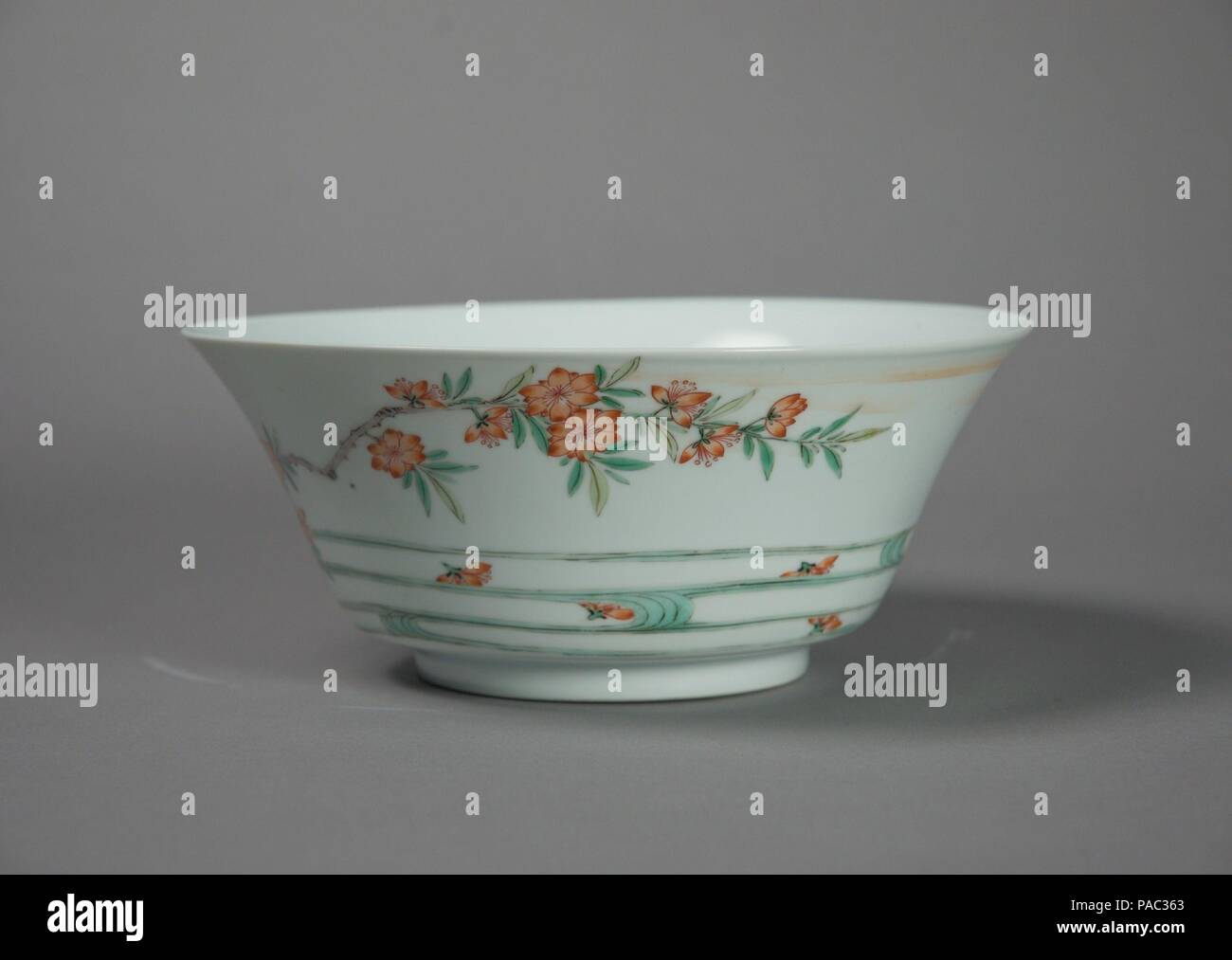 Bowl with Flowers and Waves. Culture: China. Dimensions: Diam. 8 1/4 in. (21 cm). Date: late 17th-early 18th century.  The six Chinese characters on the bottom of this bowl read 'made during the reign of the Chenghua Emperor.' Although the Chenghua Emperor ruled from 1467 to 1487, this particular bowl was made several centuries later. Chinese porcelains are sometimes inscribed with earlier dates; these can be read as both an act of respect toward past traditions and a statement of quality. Museum: Metropolitan Museum of Art, New York, USA. - Stock Image