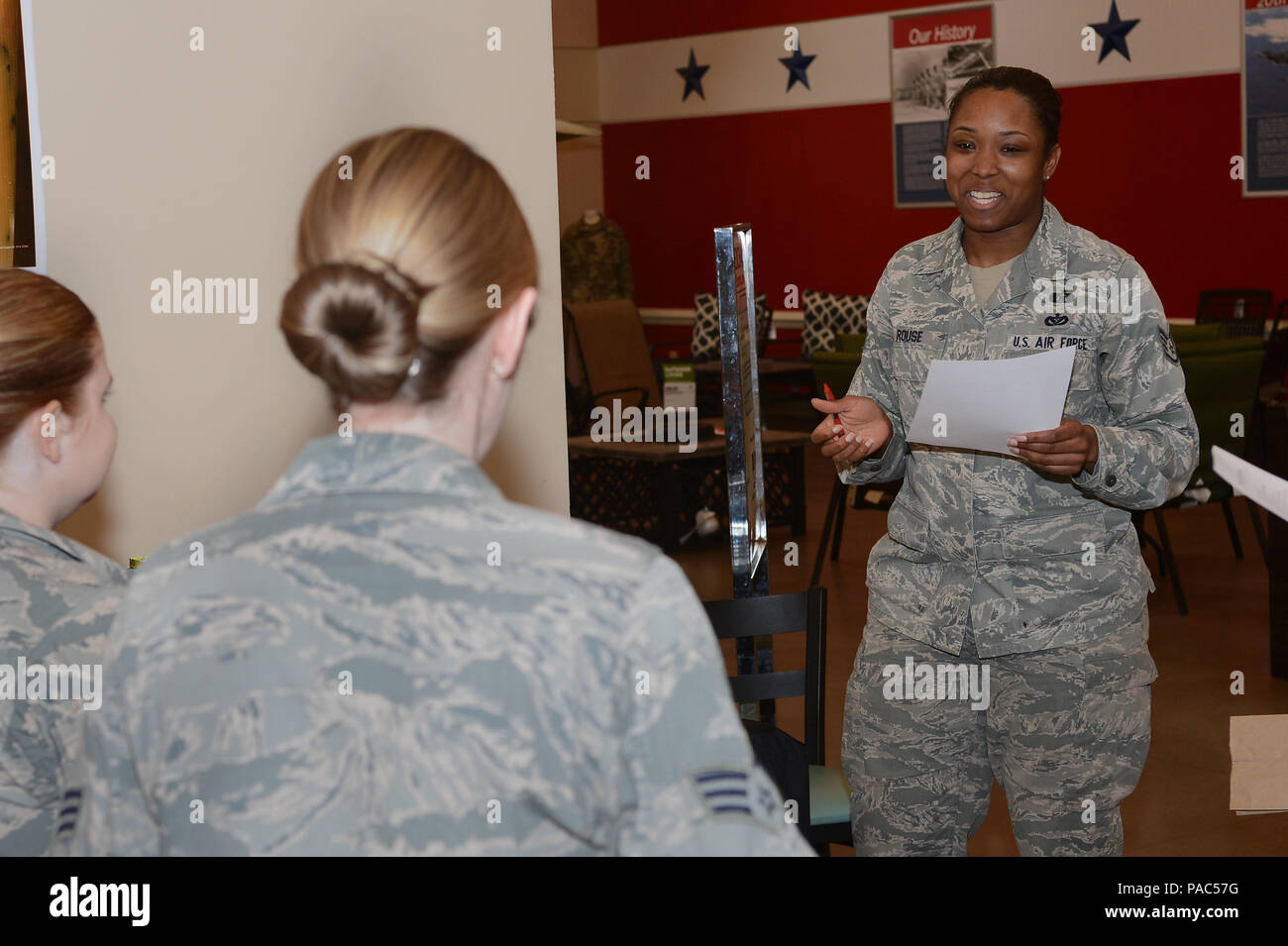 U.S. Air Force Staff Sgt. Catrina Rouse, 20th Civil Engineer Squadron noncommissioned officer in charge of plans and operations, explains the rules for the Women's History Month scavenger hunt to participants at Shaw Air Force Base, S.C., March 4, 2016. The scavenger hunt was the first event held by the Women's History Month committee this year, and led participants to various buildings around base in search of clues relating to prominent women in U.S. history. (U.S. Air Force photo by Senior Airman Zade Vadnais) - Stock Image