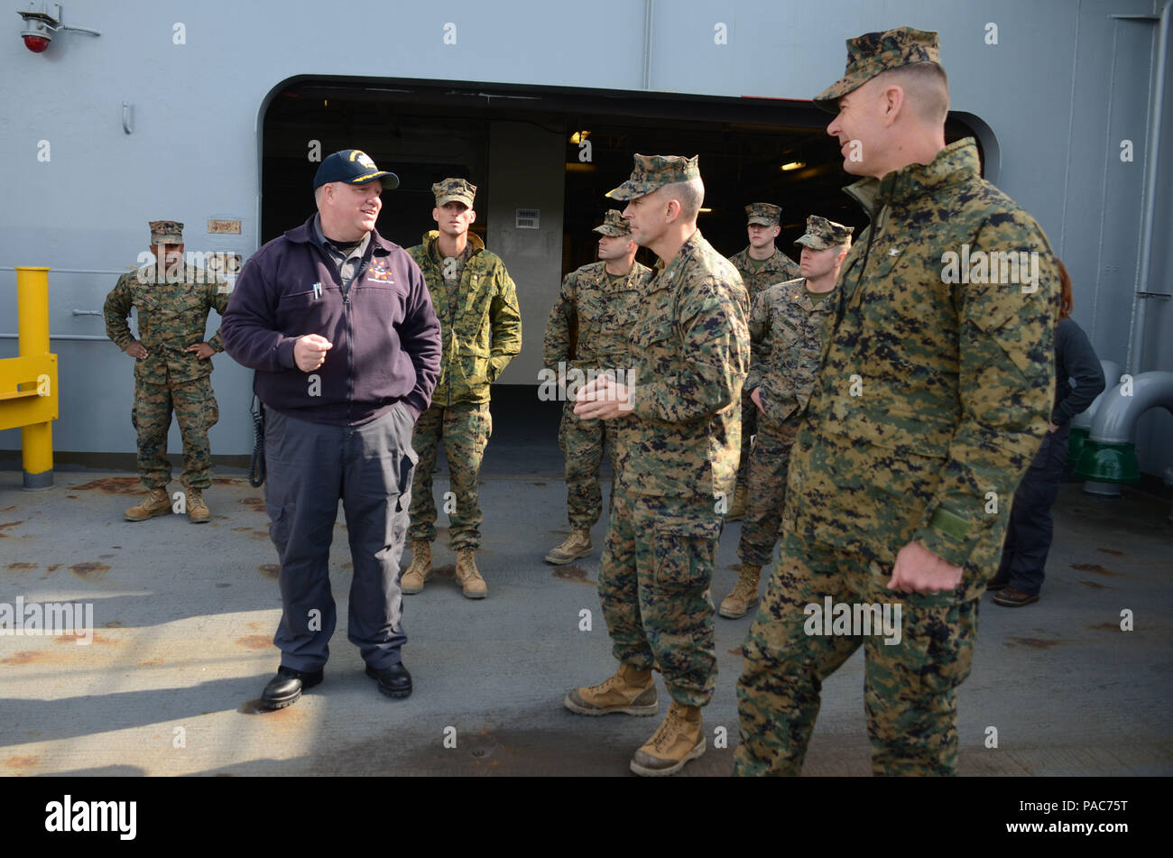 160310-N-WJ640-017 GWANGYANG, South Korea (Mar. 10, 2016) — Marines with Combat Logistics Regiment (CLR-35), 3rd Marine Logistics Group, and 4th Marine Regiment, 4th Marine Division, receive a tour of USNS Sacagawea (T-AKE 2) from Edward Dickerson, master of the Sacagawea, March 8. CLR-35 will be joining the Sacagawea later this week in Pohang as part of Exercise Ssang Yong 16, under the Exercise Freedom Banner 2016 directive. (U.S. Navy photo by Mass Communication Specialist 3rd Class Madailein Abbott/Released) Stock Photo