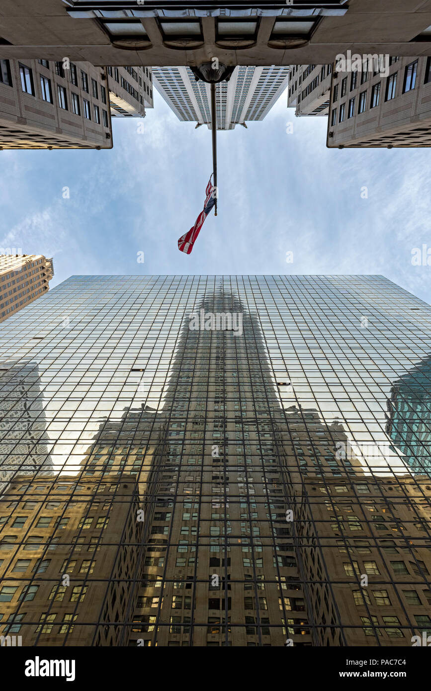 Chrysler Building reflected in Grand Hyatt Hotel, Manhattan, New York City, USA - Stock Image