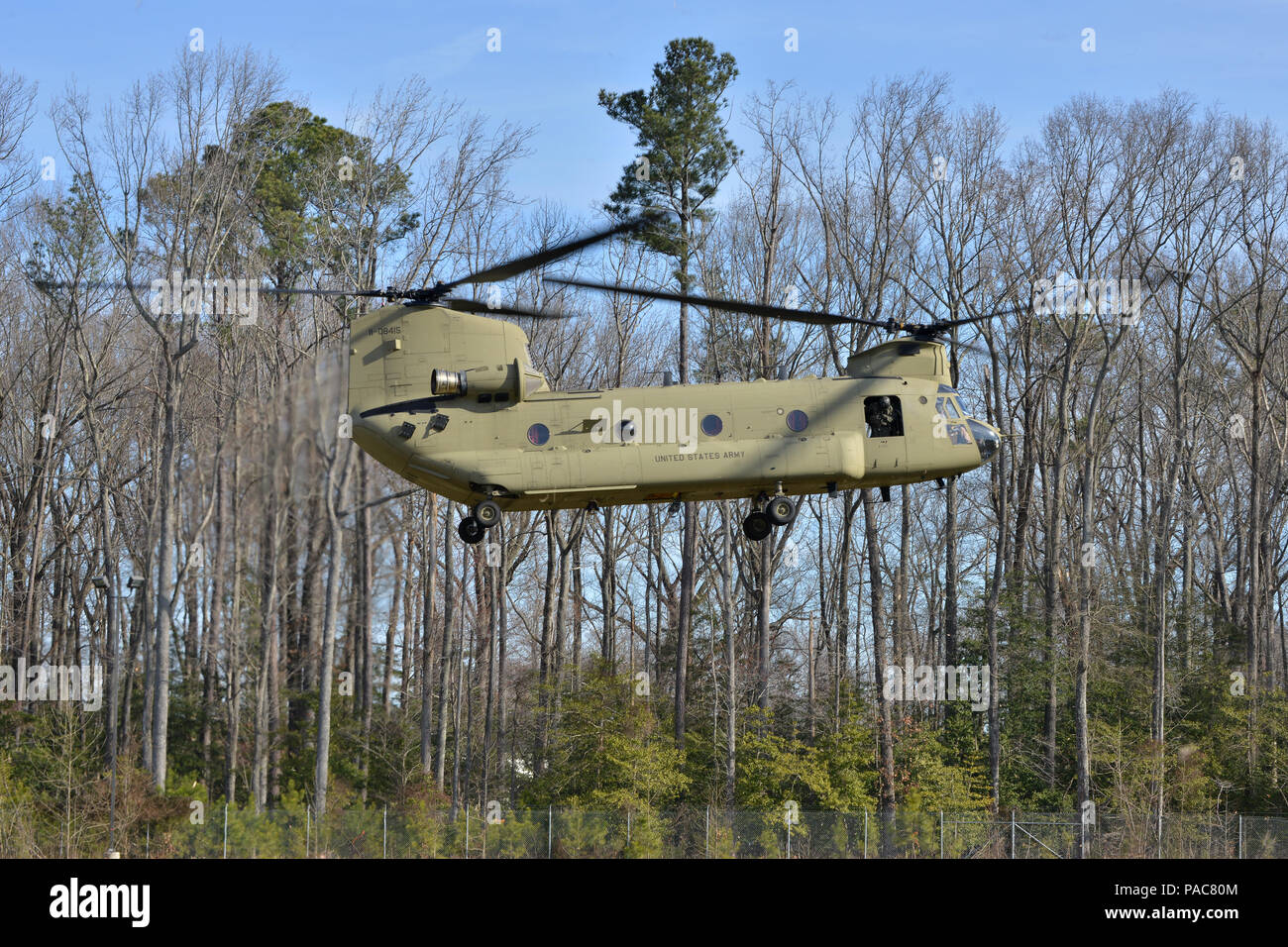 A CH-47 Chinook helicopter lands in support of a casualty evacuation exercise at Fort Eustis, Va., March 3, 2016. The 159th Aviation Regiment, 5th Battalion Chinook crew supported the 558th Transportation Company by providing evacuation transport. (U.S. Air Force photo by Staff Sgt. Natasha Stannard) - Stock Image