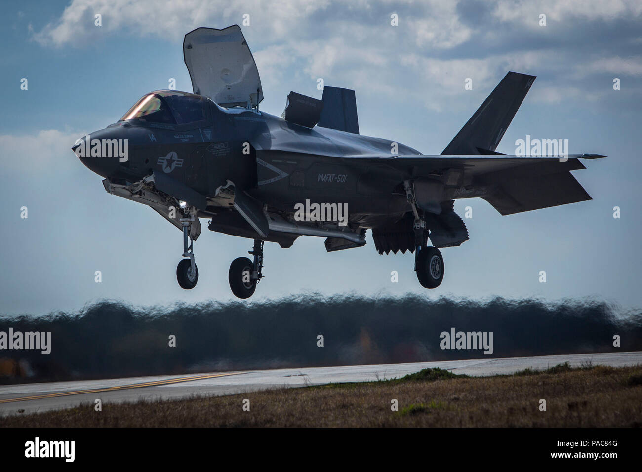 An F-35B Lightning II performs a vertical landing aboard Marine Corps Air Station Beaufort. The F-35B is the short takeoff and vertical landing variant of the jet which uses a jet propulsion system to execute the landing. The aircraft is with Marine Fighter Attack Training Squadron 501. - Stock Image