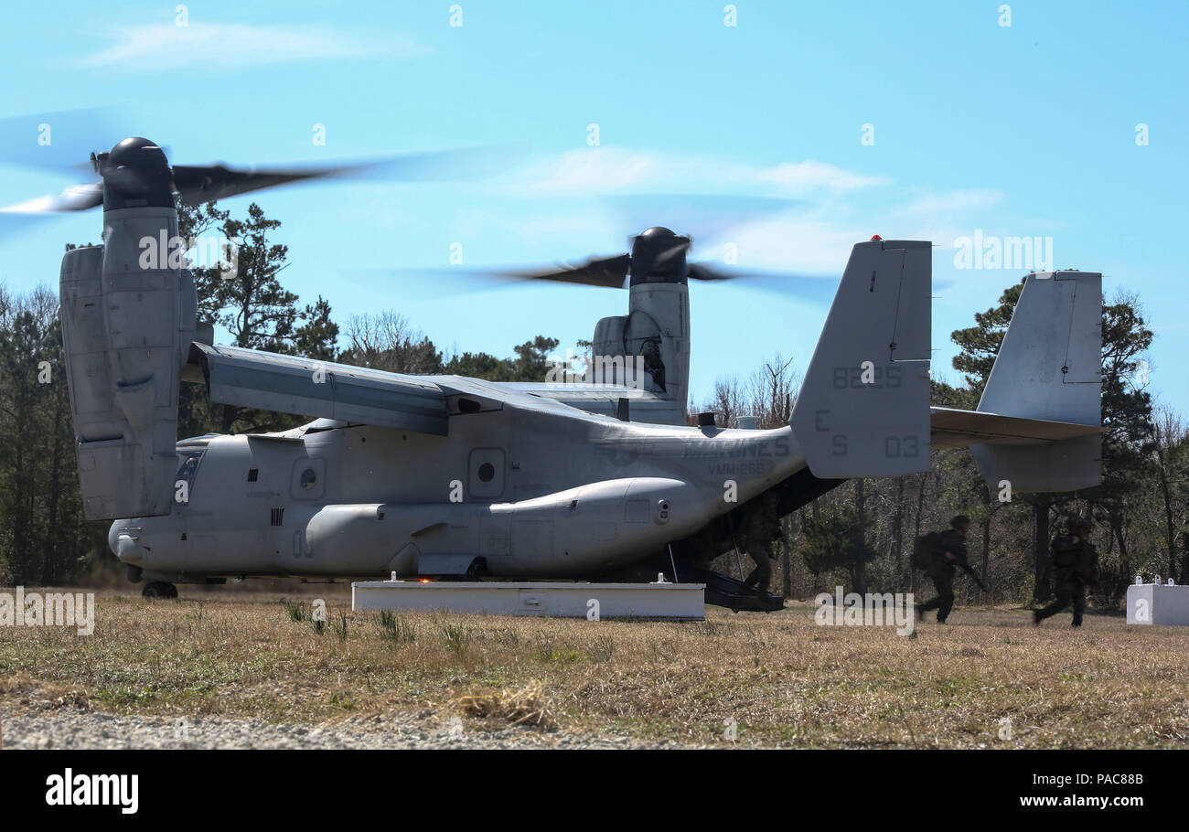 Marines with Echo Company, 2nd Battalion, 8th Marine Regiment, exit an MV-22B Osprey during a field exercise at Camp Lejeune, N.C., March 10, 2016. The aircraft, operated by Marines with Marine Medium Tiltrotor Squadron 266, assisted the company in making an aerial insert. (U.S. Marine Corps photo by Cpl. Paul S. Martinez/Released) Stock Photo