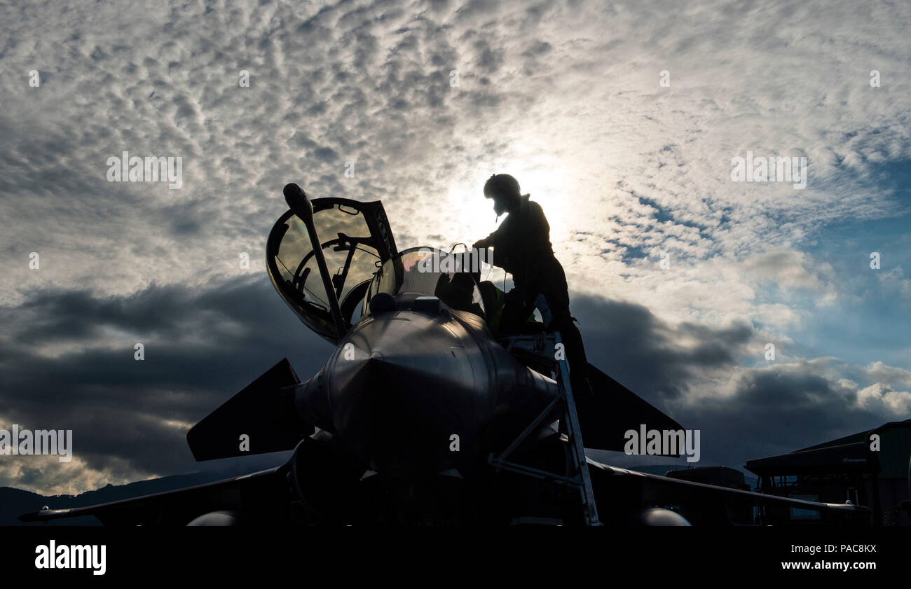 A French air force fighter pilot climbs out of a Dassault Rafale, a French twin-engine, canard delta wing, multirole fighter aircraft after participating in a joint terminal attack controller training scenario during exercise SERPENTEX 16' during exercise SERPENTEX 16, March 10, 2016, in Corsica, France. The multinational exercise is focused on the training of U.S. and NATO aircrew and JTACs in the Air Land integration mission, to include close air support, dynamic targeting, strike coordination and reconnaissance and live ordnance operations. (U.S. Air Force phot0/Staff Sgt. Sara Keller) - Stock Image
