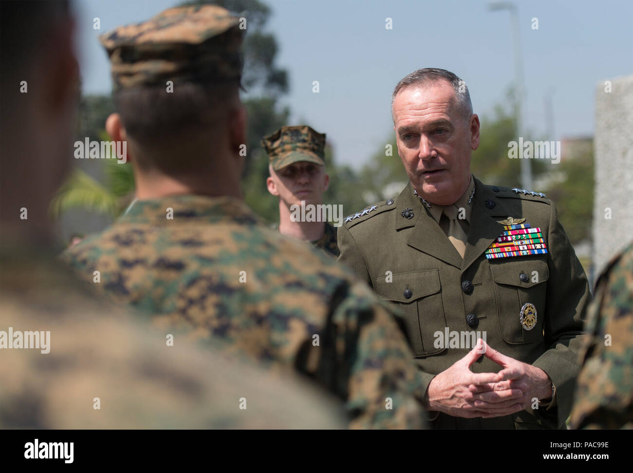 U.S. Marine Gen. Joseph F. Dunford Jr., chairman of the Joint Chiefs of Staff, meets with Marines assigned to the Marine Security Detachment at the U.S. Embassy in Bogota, Colombia, March. 10, 2016. Dunford met with senior U.S. and Colombian military and civilian leaders for his first visit to Colombia as Chairman. (DoD Photo by Navy Petty Officer 2nd Class Dominique A. Pineiro) - Stock Image