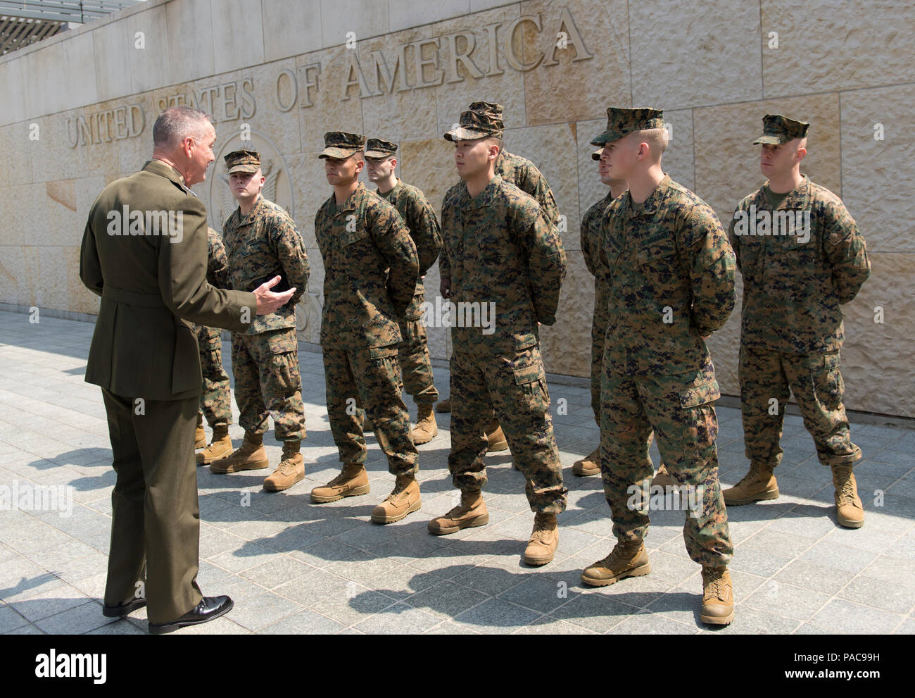 U.S. Marine Gen. Joseph F. Dunford Jr., chairman of the Joint Chiefs of Staff, meets with Marines assigned to the Marine Security Detachment at the U.S. Embassy in Bogota, Colombia, March 10, 2016. Dunford met with senior U.S. and Colombian military and civilian leaders for his first visit to Colombia as Chairman. (DoD Photo by Navy Petty Officer 2nd Class Dominique A. Pineiro) - Stock Image