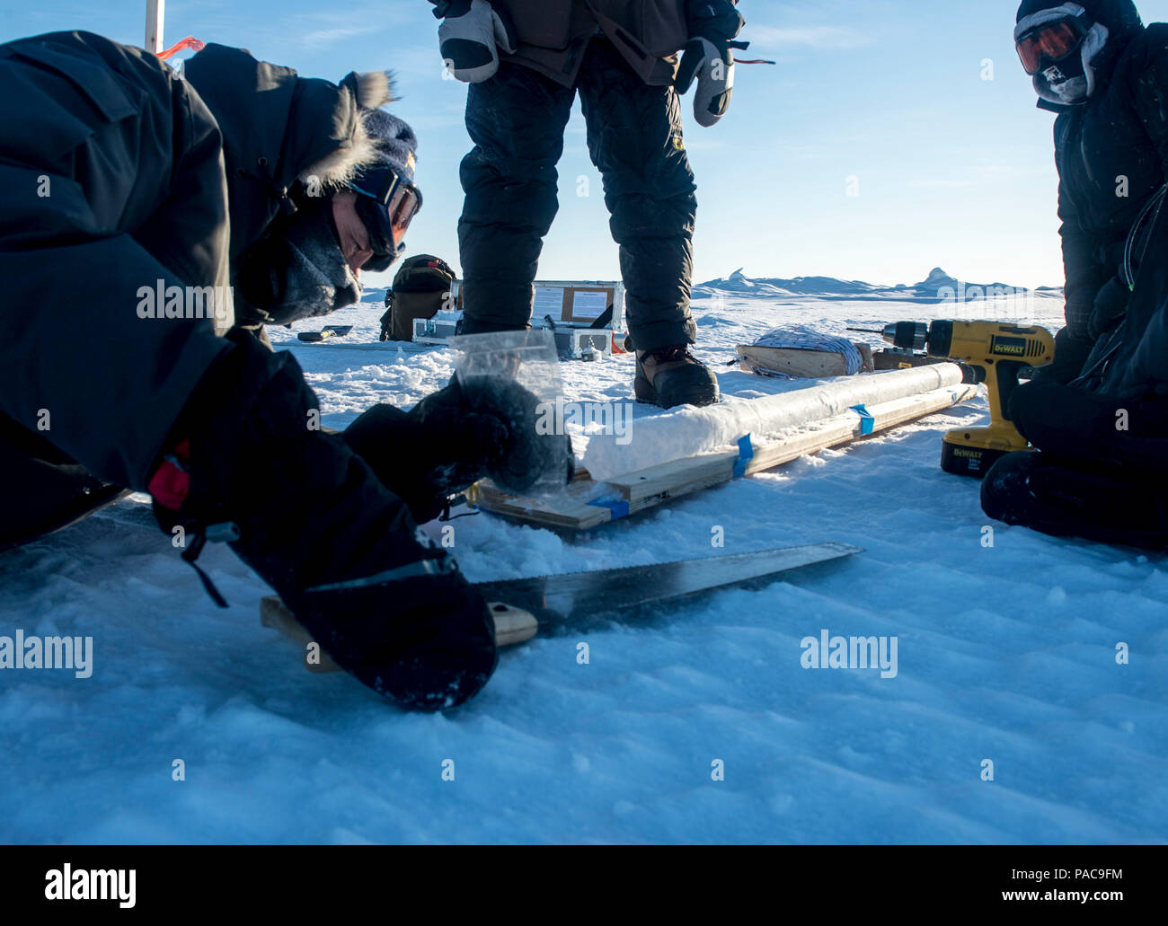 160308-N-QA919-002-1 Arctic Circle (March 08, 2016) - Dr. Rick Hagen, left, and Dr. Joan Gardner, with the Naval Research Laboratory (NRL) gather ice core samples in the Arctic Circle, March 8. The core samples will help the scientists measure salinity and density as part on an ongoing ice characterization research project, during Ice Exercise (ICEX) 2016. ICEX 2016 is a five-week exercise designed to research, test, and evaluate operational capabilities in the region. ICEX 2016 allows the U.S. Navy to assess operational readiness in the Arctic, increase experience in the region, advance under - Stock Image