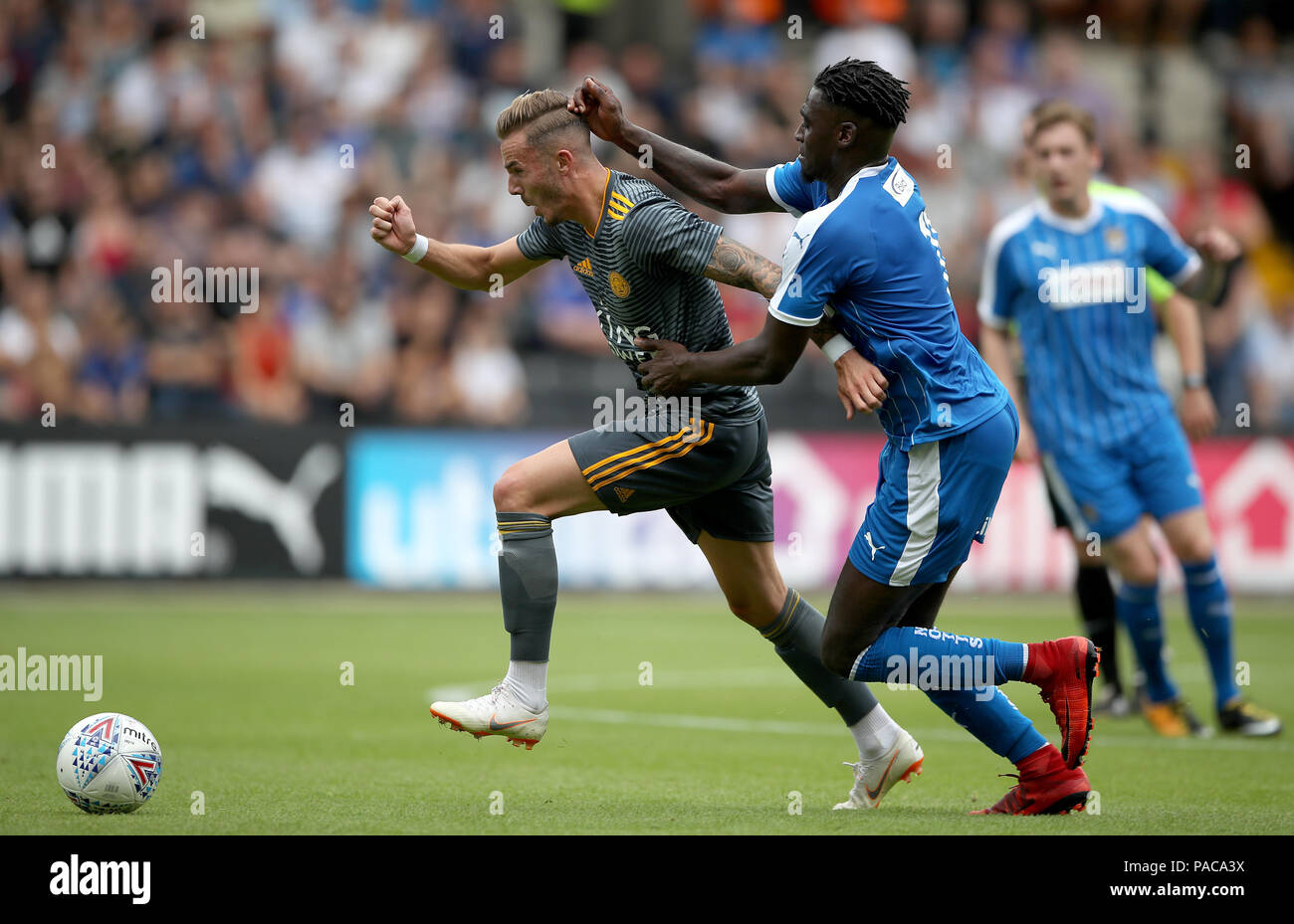 Leicester City's James Maddison (left) and Notts County's Enzio Boldewijn battle for the ball during a pre season friendly match at Meadow Lane, Nottingham. - Stock Image
