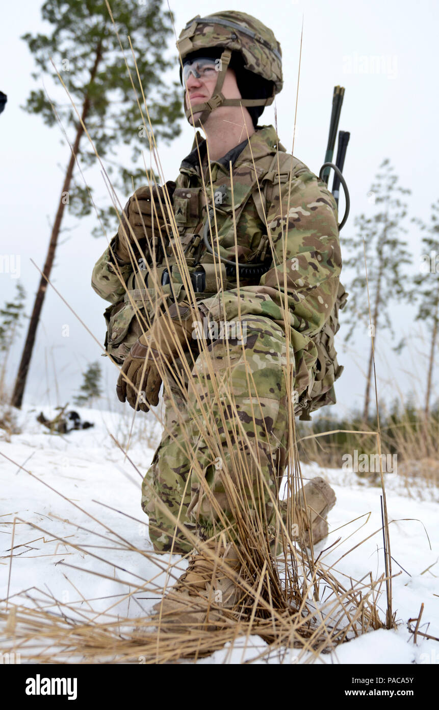 Cpl. Travis Bullins, an Iron Troop communications specialist plays the role of the commander's radiotelephone operator during a live fire exercise at Tapa Training Area in Estonia, Mar. 8-11, 2016. (Photo by U.S. Army Staff Sgt. Steven M. Colvin/Released) - Stock Image