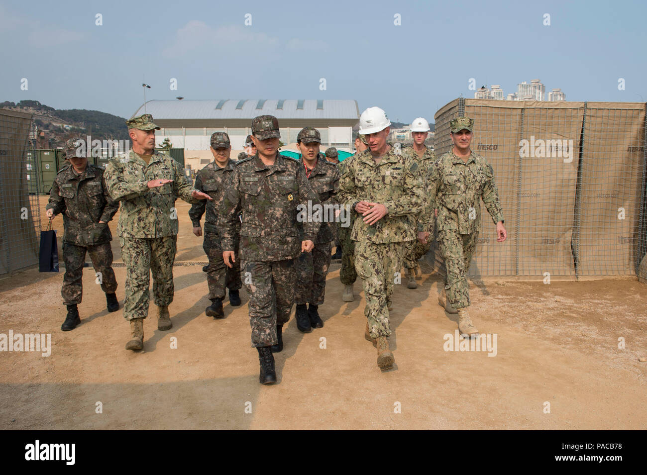 160314-N-HA376-197 BUSAN, Republic of Korea (March 14, 2016) - U.S. Navy Capt. James Meyer, commodore, 30th Naval Construction Regiment, speaks with Commander Republic of Korea (ROK) Fleet Vice Adm. Lee, Ki-sik, during a tour of a joint U.S. and ROK construction site during exercise Foal Eagle 2016. Lee visited the site to see the various expeditionary facilities built by U.S. Navy and ROK Seabees during the exercise. Foal Eagle is an annual, bilateral training exercise designed to enhance the readiness of U.S. and ROK forces, and their ability to work together during a crisis. (U.S. Navy phot - Stock Image