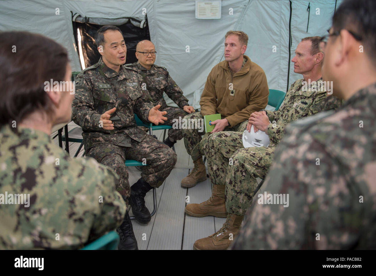 160314-N-HA376-494 BUSAN, Republic of Korea (March 14, 2016) - Republic of Korea (ROK) Navy Capt. Jung, Minh-wan, ROK engineering bureau chief, speaks about further U.S. and ROK engagements with Capt. James Meyer, commodore, 30th Naval Construction Regiment (30 NCR) and Cmdr. Ross Campbell,  30 NCR operations officer, during exercise Foal Eagle 2016.  30 NCR is forward deployed to provide command and control of U.S. Navy Seabees working with their ROK counterparts during Foal Eagle. Foal Eagle is an annual, bilateral training exercise designed to enhance the readiness of U.S. and ROK forces, a - Stock Image