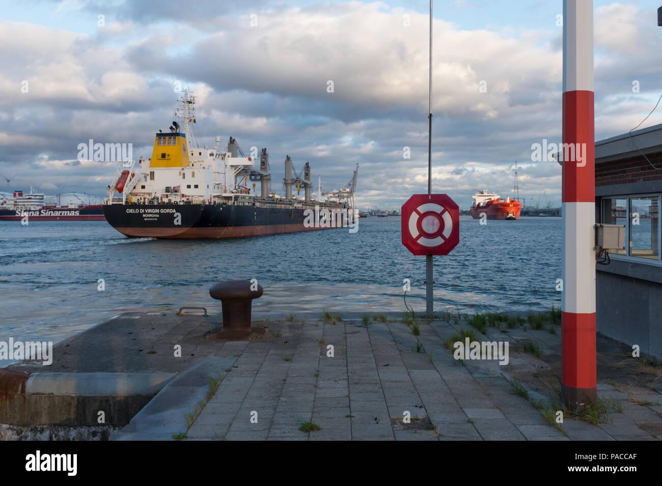 Bulk Carrier sailing out of the lock 'Boudewijnsluis', in the port of Antwerp, Belgium. - Stock Image