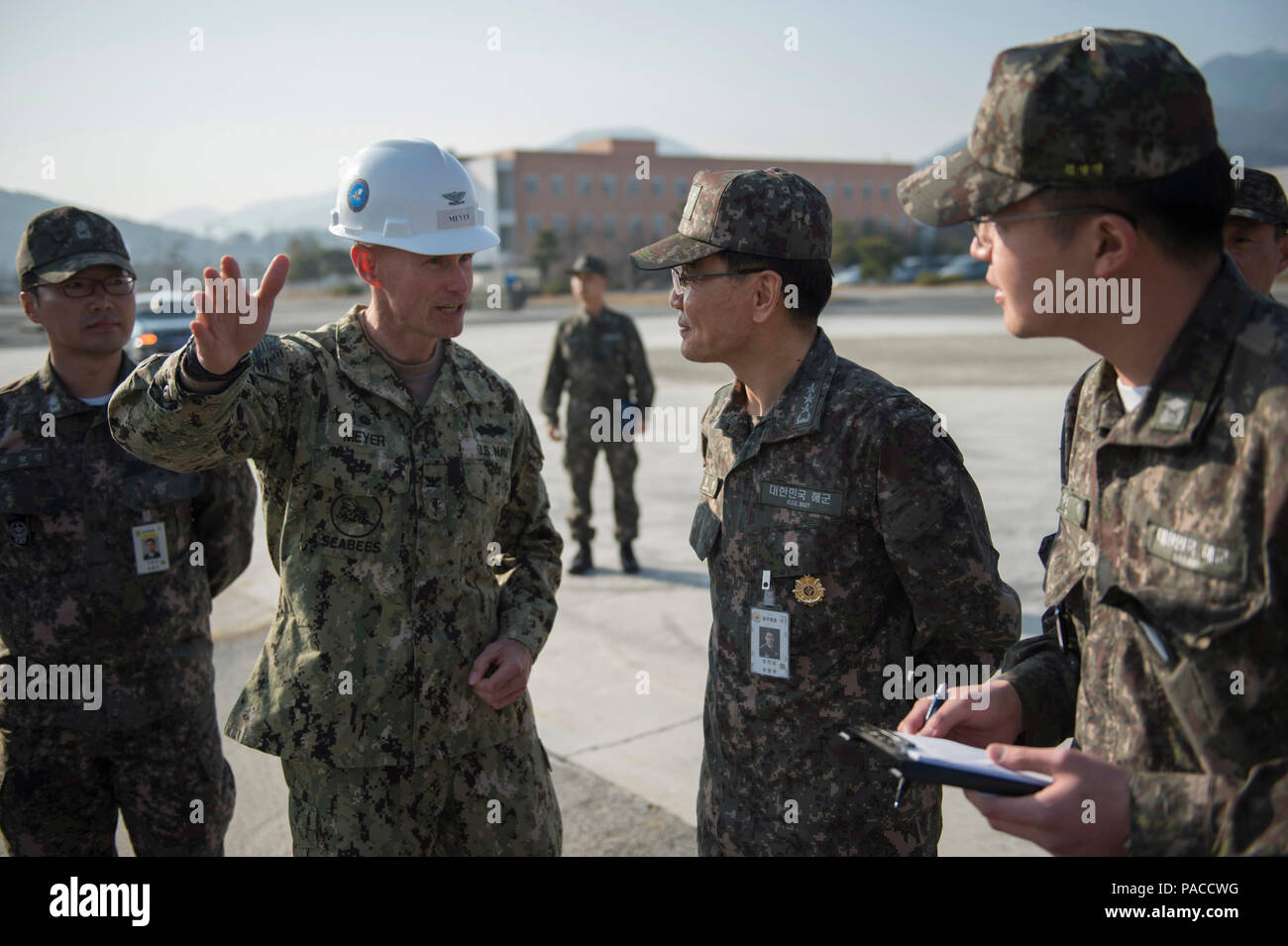 160315-N-HA376-573 JINHAE, Republic of Korea (March 15, 2016) - U.S. Navy Capt. James Meyer, commodore, 30th Naval Construction Regiment (30 NCR), speaks with Republic of Korea (ROK) Navy Vice Adm. Jung, Jin-soep, during exercise Foal Eagle 2016. 30 NCR is forward deployed to provide command and control of U.S. Navy Seabees working with their ROK counterparts during Foal Eagle. Foal Eagle is an annual, bilateral training exercise designed to enhance the readiness of U.S. and ROK forces, and their ability to work together during a crisis. (U.S. Navy photo by Chief Mass Communication Specialist  - Stock Image