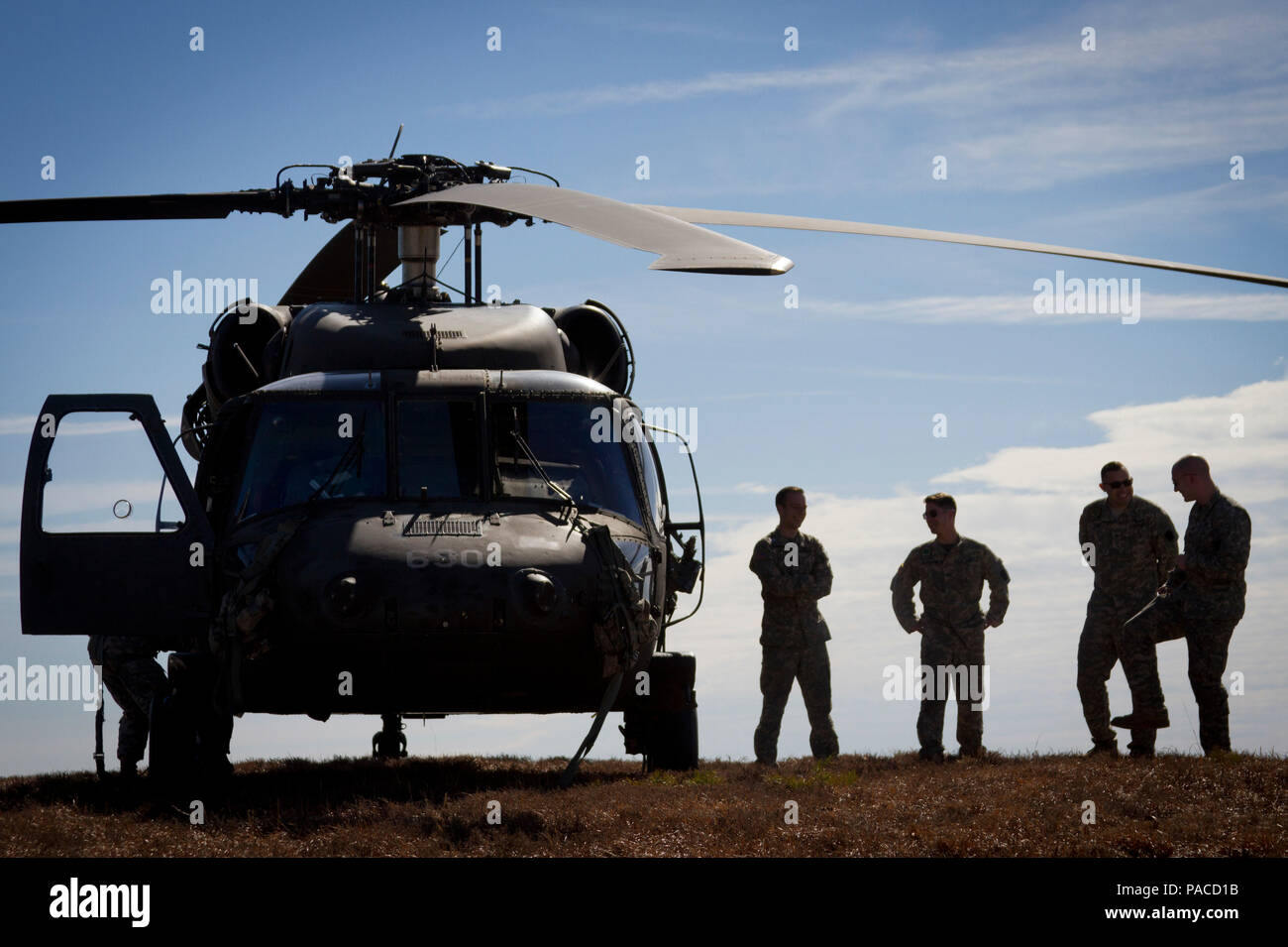 U.S. Army National Guard crew chiefs stand next to a 1-150th Assault  Helicopter Battalion Black Hawk before a helicopter-borne parachute jump at  Coyle Drop ... f959ca6bc