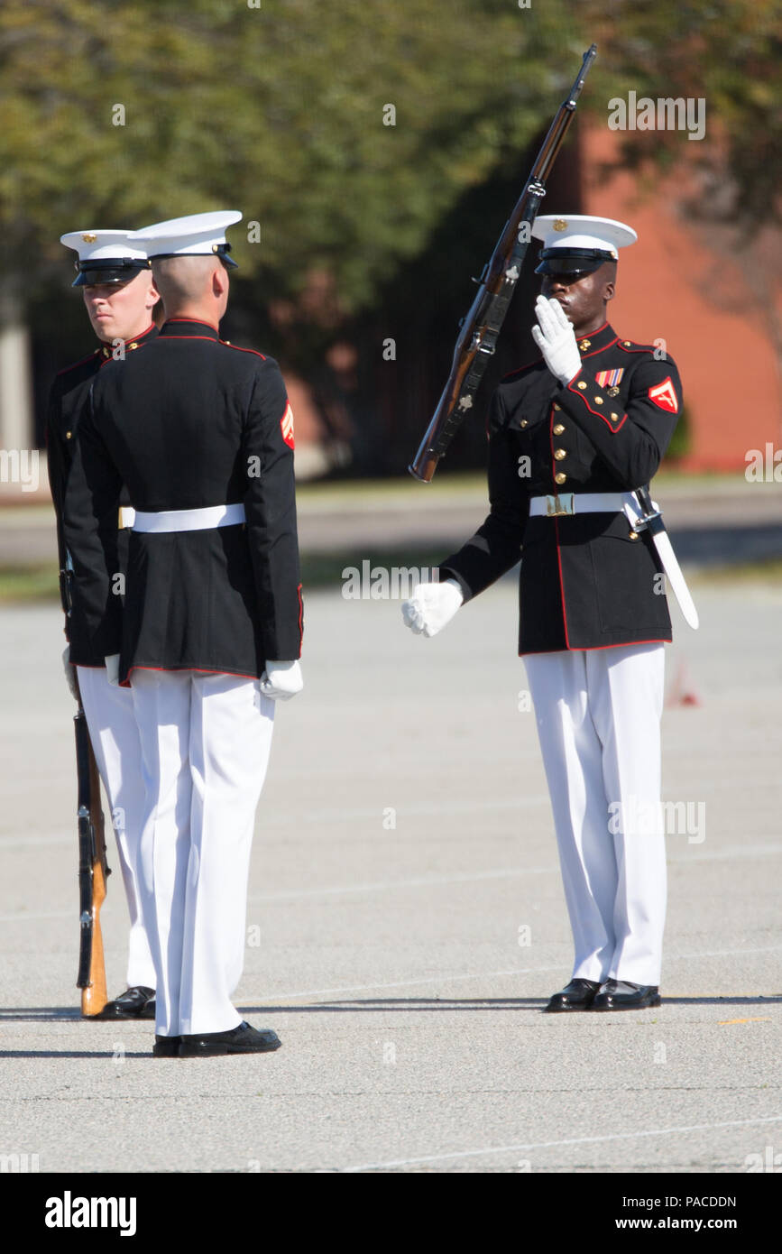 7eb6de030b0 Marines of the Silent Drill Platoon perform a precision drill movement with M1  Garand rifles March