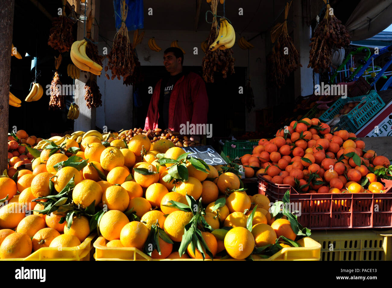 Market in the north of Tunesia, where farmers are producing many types of fruits and vegetables and the world famous olives. - Stock Image