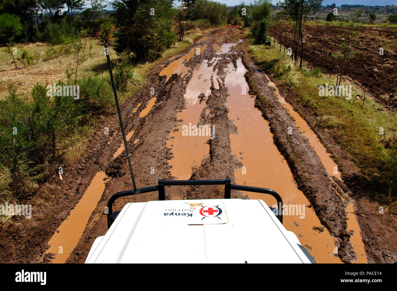 Kenya Red Cross Mission Eldoret: Dirty roads and sometimes bloody work. bad condition and trouble-shooting everywhere Stock Photo