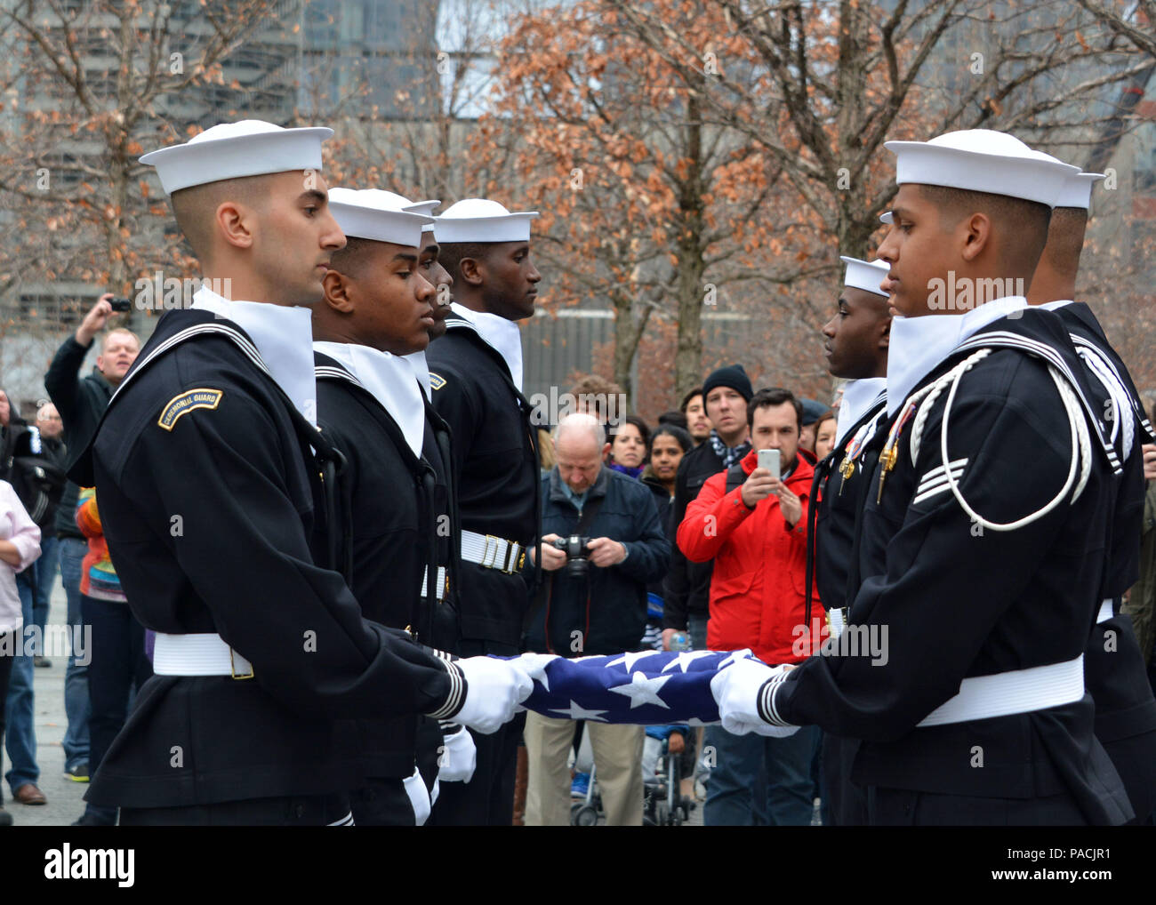 160315-N-LV695-015 NEW YORK (March 15, 2015) U.S. Navy Ceremonial Guardsmen conduct a flag presentation at the 9/11 Memorial Museum. The Ceremonial Guard is the Navy's most prestigious unit and conducts ceremonies for Presidential inaugurations, distinguished visitors, and burials at Arlington National Cemetery. (U.S. Navy photo by Mass Communication Specialist 2nd Class Destiny Cheek/Released) Stock Photo