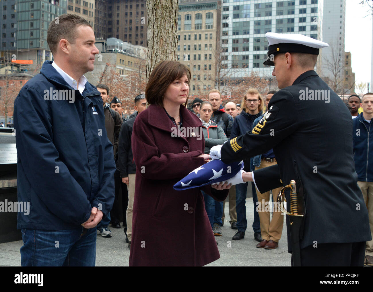 160315-N-LV695-068 NEW YORK (March 15, 2015) Senior Chief Operations Specialist Ryan King, assigned to U.S. Navy Ceremonial Guard, hands off a flag to show support for the staff at the 9/11 Memorial Museum. The ceremonial guard is the Navy's most prestigious unit and conducts ceremonies for presidential inaugurations, distinguished visitors, and burials at Arlington National Cemetery. (U.S. Navy photo by Mass Communication Specialist 2nd Class Destiny Cheek/Released) Stock Photo