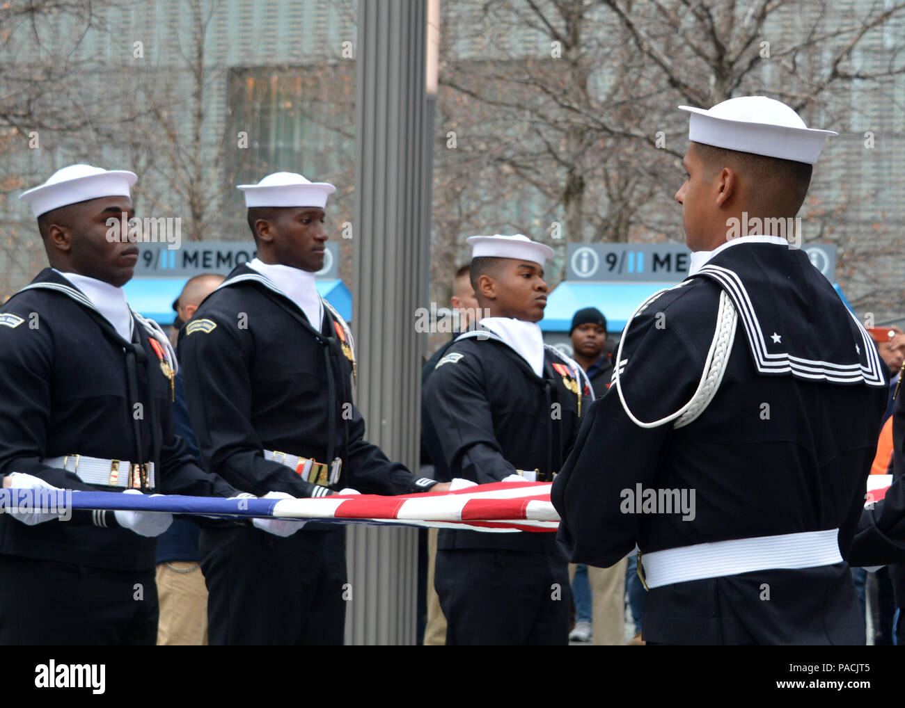 160315-N-LV695-047 NEW YORK (March 15, 2015) U.S. Navy Ceremonial Guardsmen conduct a flag presentation at the 9/11 Memorial Museum. The Ceremonial Guard is the Navy's most prestigious unit and conducts ceremonies for Presidential inaugurations, distinguished visitors, and burials at Arlington National Cemetery. (U.S. Navy photo by Mass Communication Specialist 2nd Class Destiny Cheek/Released) Stock Photo