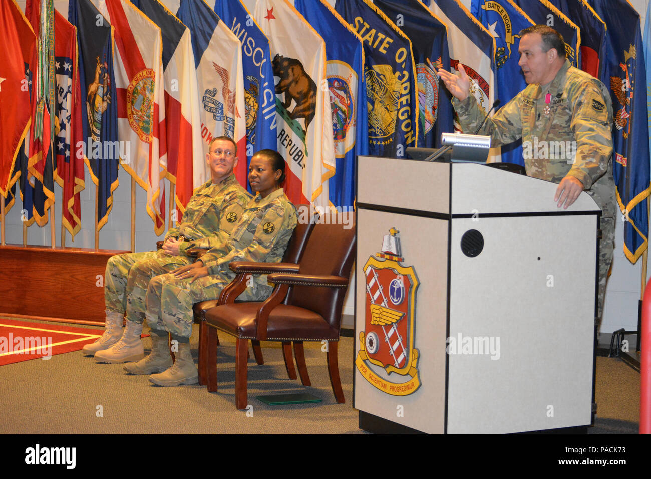 Brig. Gen. Steven W. Ainsworth, the 94th Training Division commander, and Command Sgt. Maj. Sharon Campbell, the 94th TD's new command sergeant major, listens as Command Sgt. Maj. Arlindo Almeida, the division's outgoing command sergeant major delivers his farewell address during a change or responsibility ceremony, Fort Lee, Va., where Almeida officially transferred his senior noncommissioned officer responsibilities to Campbell making her the division's first female command sergeant major March 18, 2016. - Stock Image
